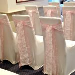 Pink sashes with lace over white lycra chair covers, Devonshire Fell wedding
