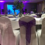 Award ceremony decor with white chair covers, white and purple sashes, Bankfield Hotel, Bradford