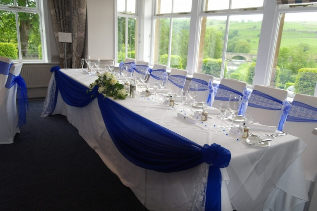 Royal blue chiffon, top table swagging for wedding breakfast