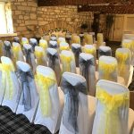 yellow and grey wedding & white chair covers