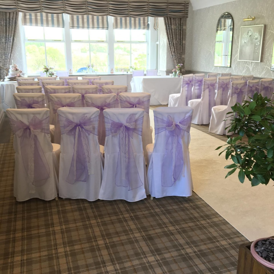 Cotton loose chair covers, lilac and lace bows. Devonshire Fell civil ceremony