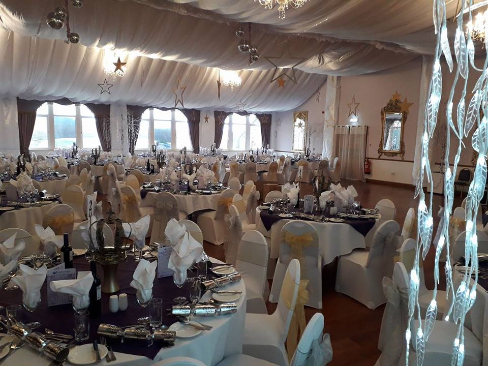 White chair covers and silver and gold bows for ball, corporate event, Rendezvous Hotel, Skipton