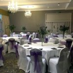 White chair covers with cadbury purple and white sashes for award ceremony, Bankfield Hotel, Bradford