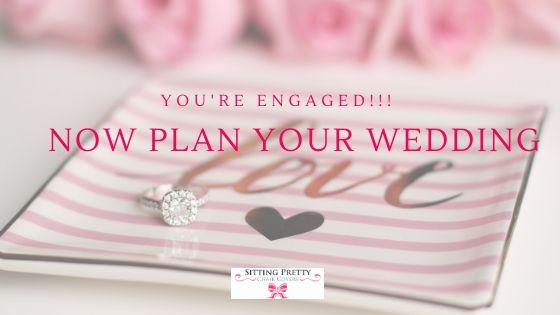Diamond engagement ring in a dish saying Love. Words read, you're engaged, now plan your wedding.