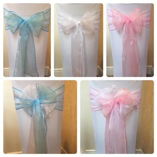 White chair covers and pink, blue or white bows for baby shower, christening or gender reveal, boy or girl