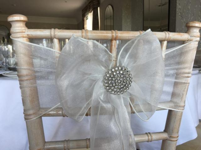 Silver sparkle brooch on ivory bow, chiavari wedding chair