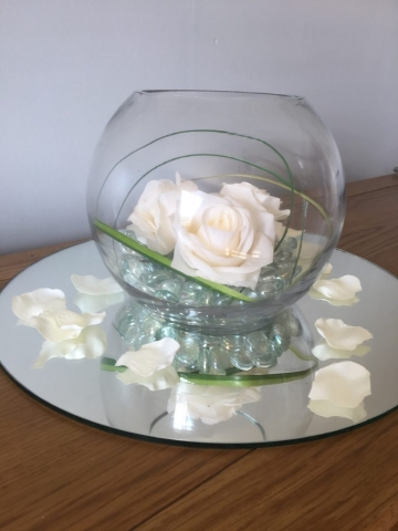 Fishbowl with ivory roses, mirror and petals, wedding or event centrepiece