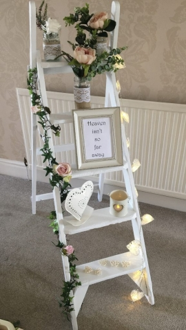 White vintage ladder for remembrance at a wedding