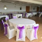 Party chair decor with ivory chair covers and cadbury purple sashes at Rendezvous Hotel, Skipton
