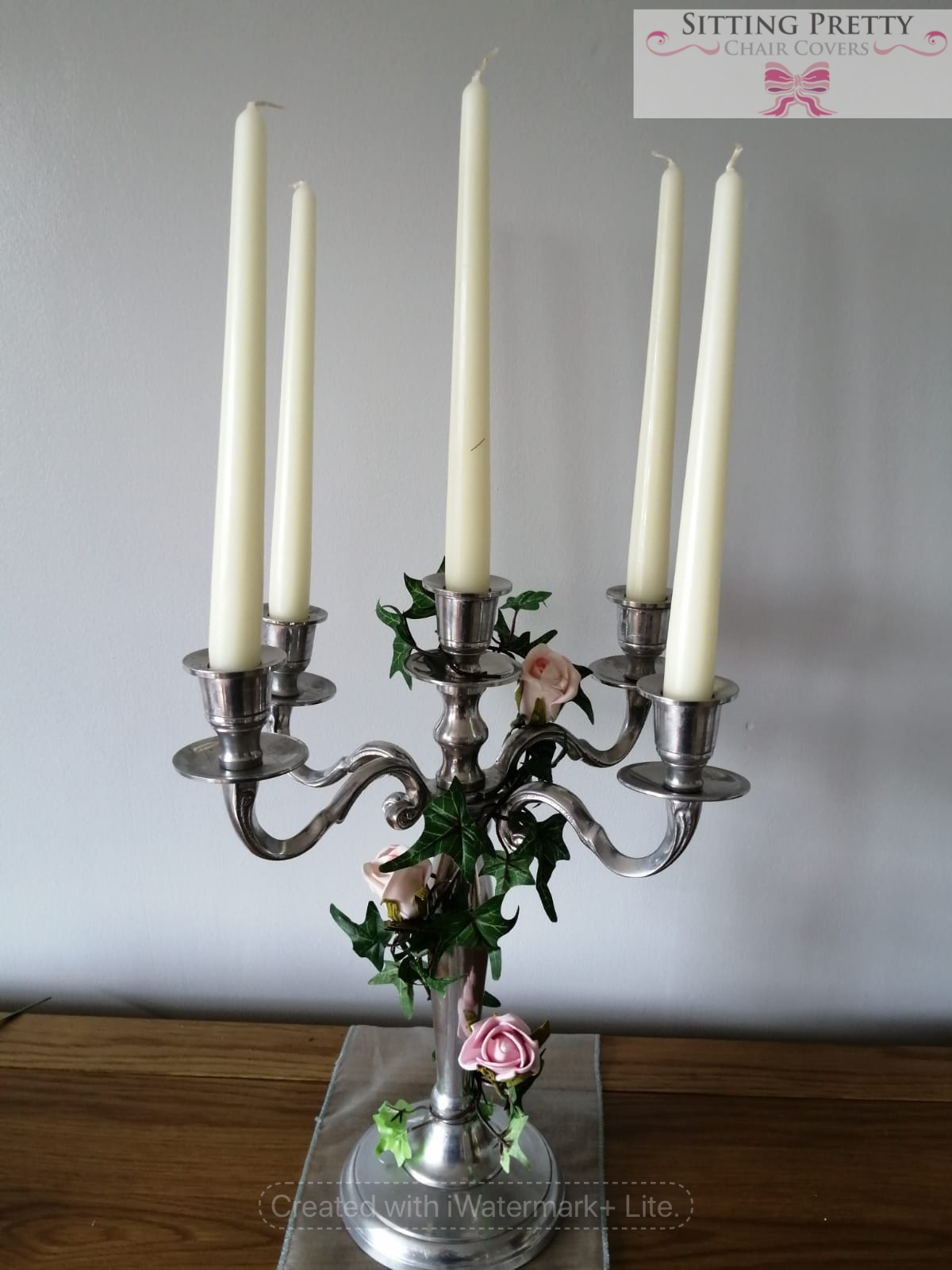 Candelabra decorated with ivy and roses, wedding centrepiece