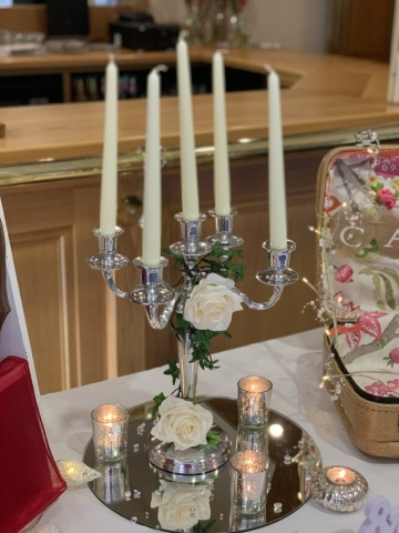 Silver candelabra, ivy and roses with tealight and mirror centrepiece