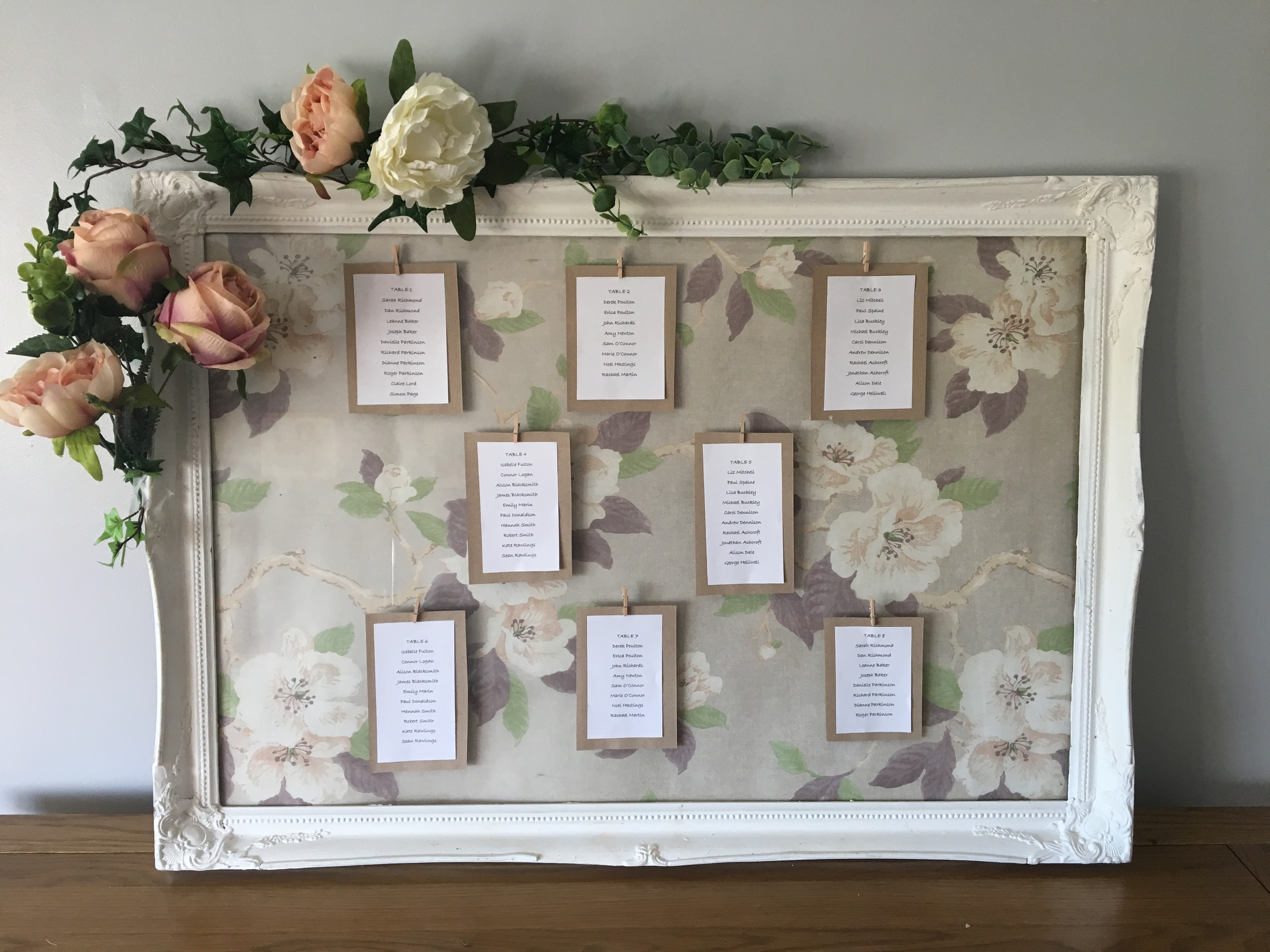 White frame table plan, customised with flowers