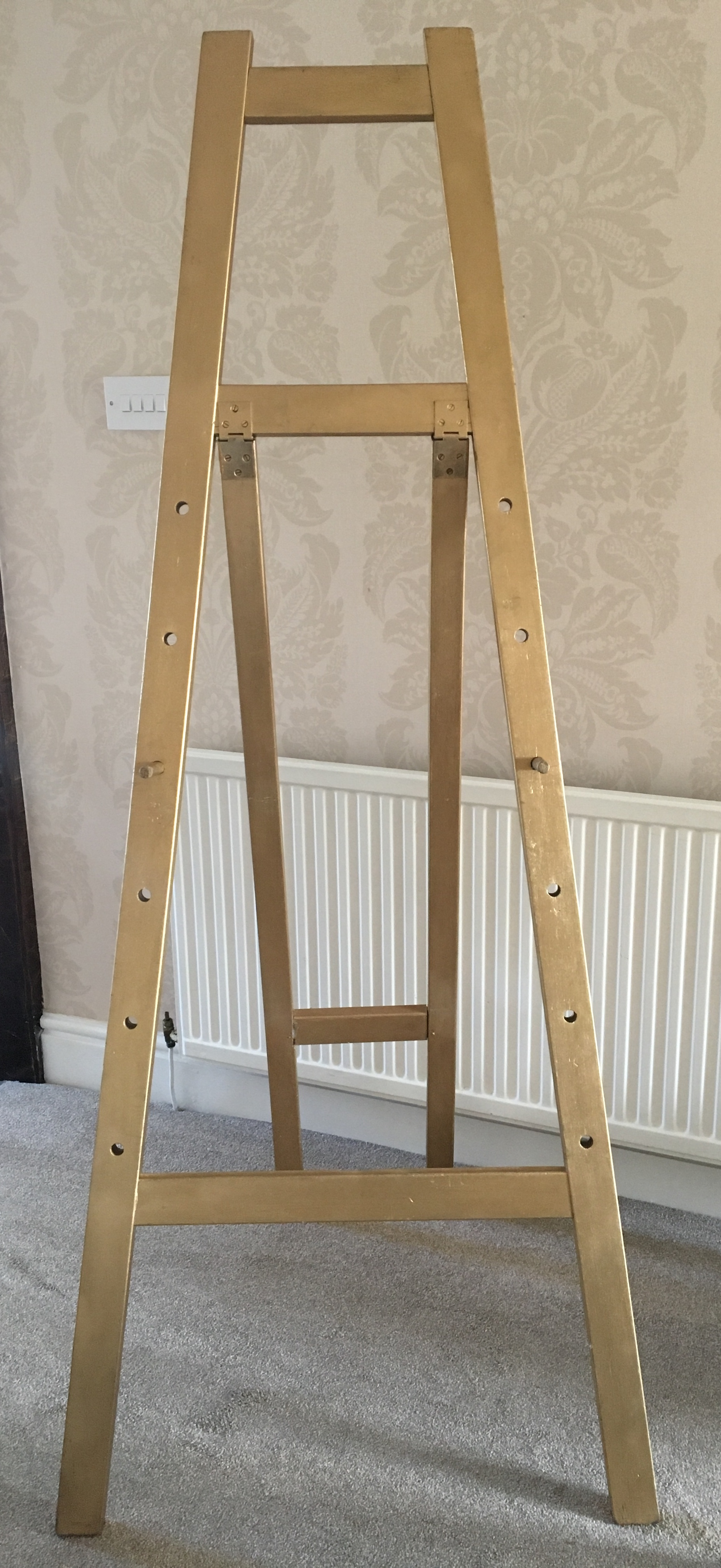 Gold easel for seating plan or wedding sign