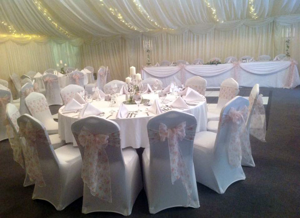Top table swagging and vintage rose sashes over white chair covers, Halfway House, Baildon
