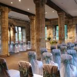 Wedding ceremony at Hospitium, York, chair covers and sashes