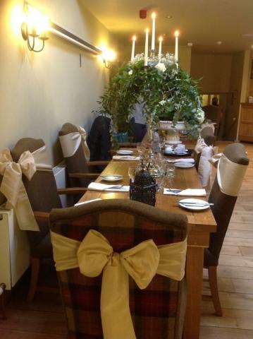 Ivory taffeta bows over tartan chairs for wedding Red Lion, Burnsall
