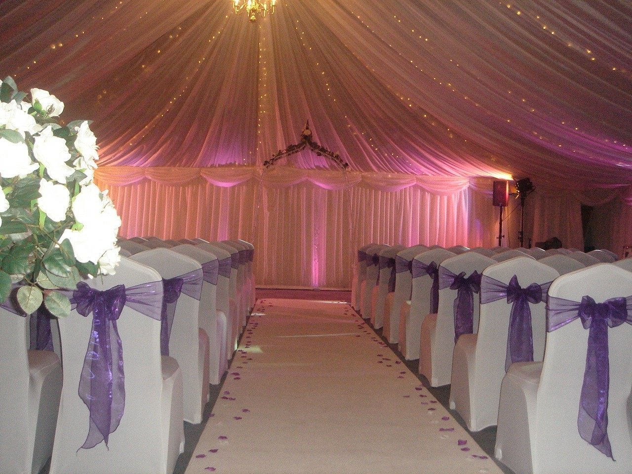 White chair covers with purple sashes, aisle carpet with petals, Halfway House, Baildon