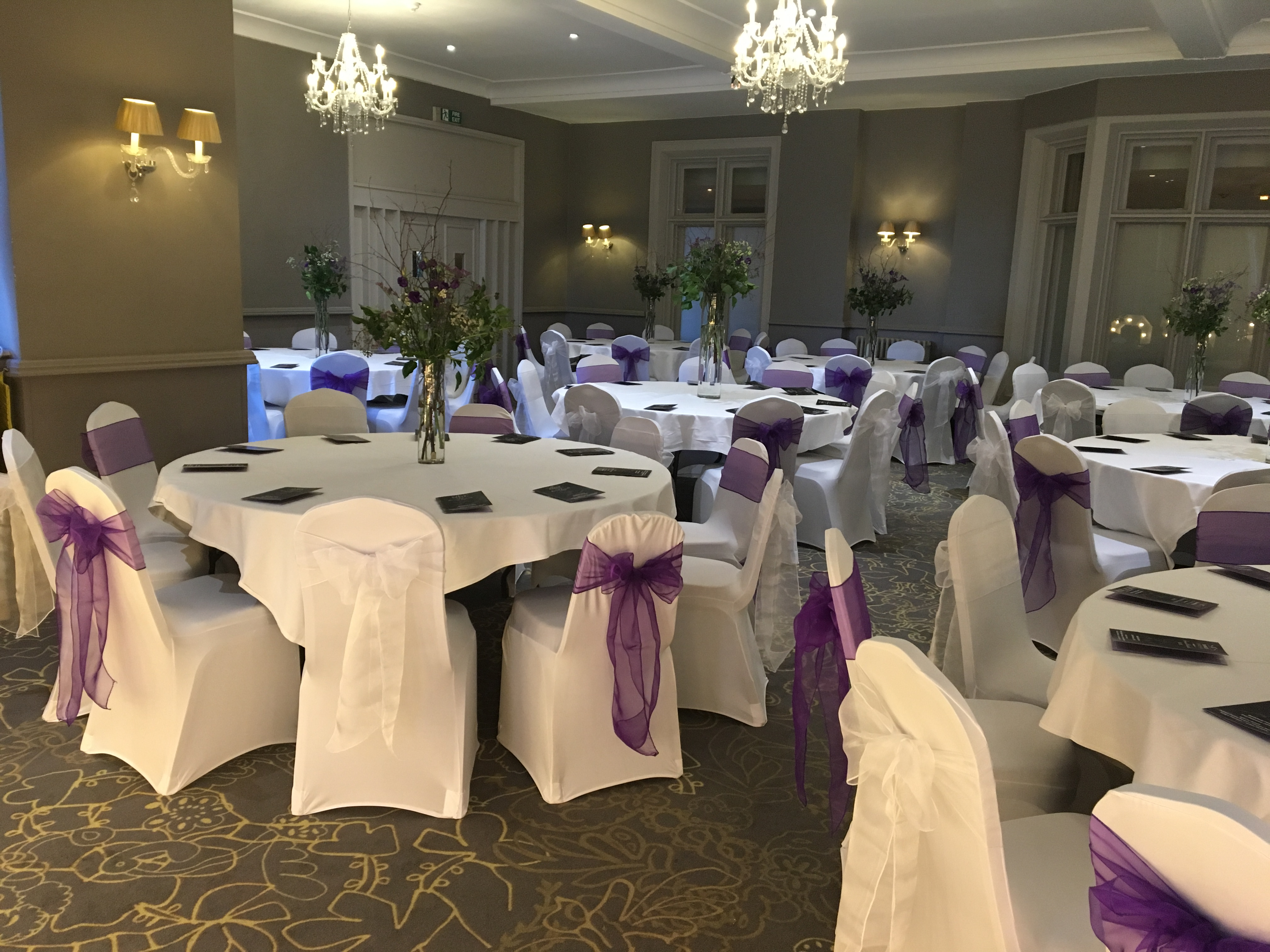 White chair covers with white and cadbury purple sashes for awards ceremony, Bankfield Hotel, Bradford