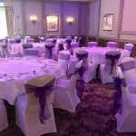 Event decoration, party chair covers, white chair covers with cadbury purple sashes, Oulton Hall