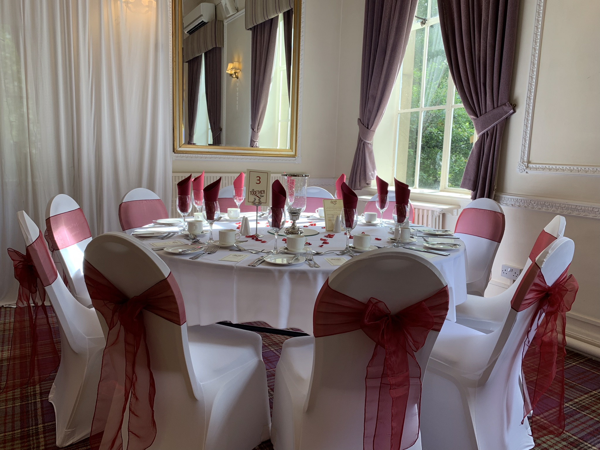 Ball chair decor, white chair covers and burgundy sahses, corporate event