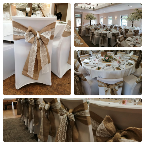 Hessian and lace sashes on white chair covers for rustic wedding at Cavendish Pavilion, Bolton Abbey
