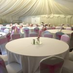 White lycra chair covers and hot pink bows for a party