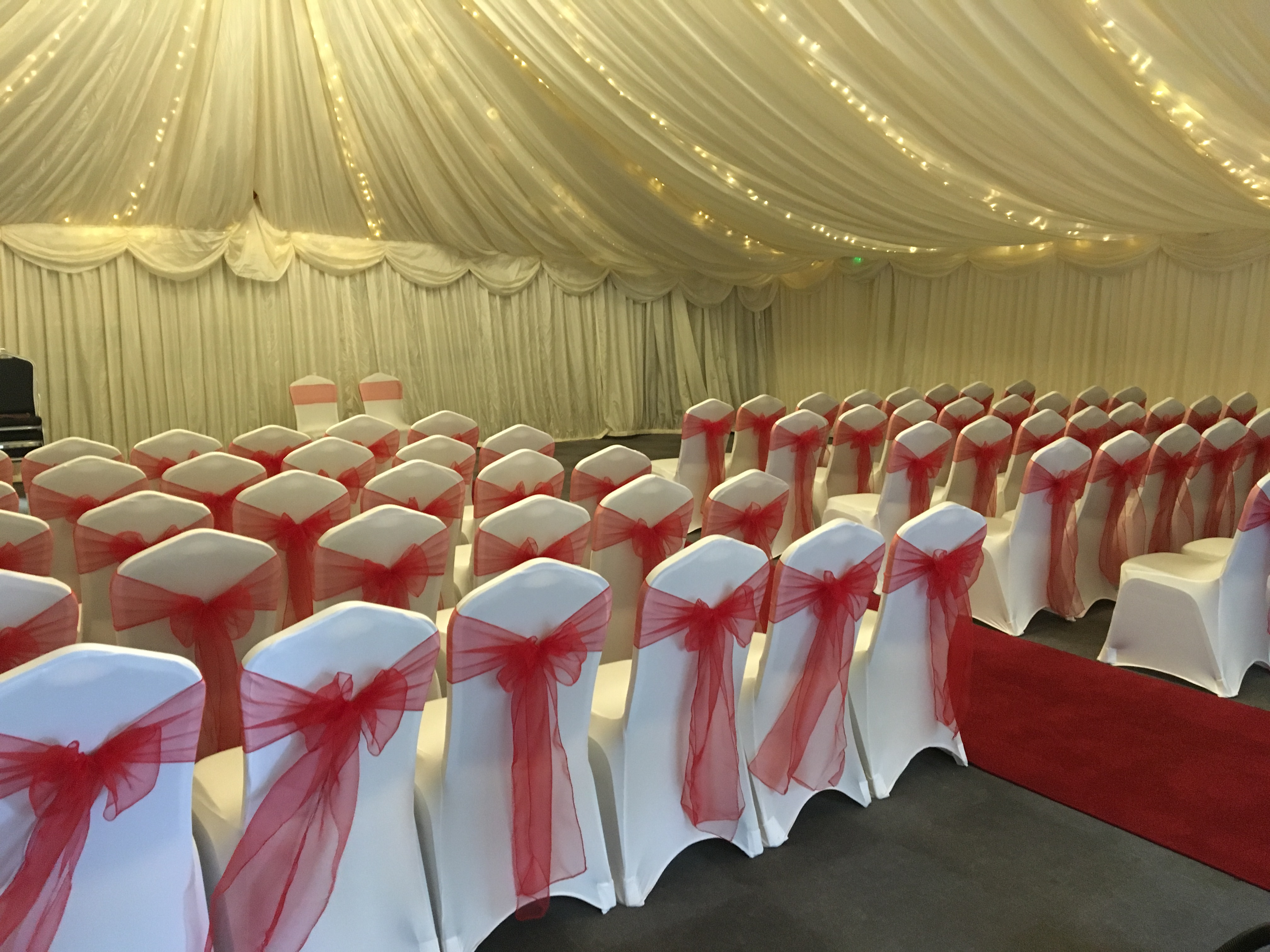 White chair covers with red sashes, red aisle carpet, Halfway House, Baildon