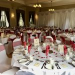 White chair covers and burgundy sashes, event decor, ball, celebration
