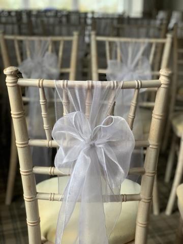 Snow white chair sash on chiavari chair for wedding at Devonshire Fell