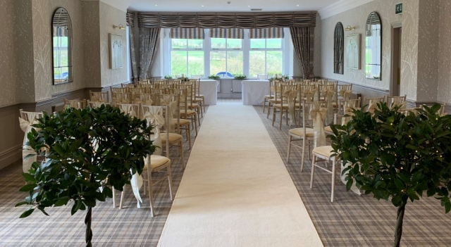 Luxurious ivory aisle carpet, wedding aisle with bay trees, aisle decor