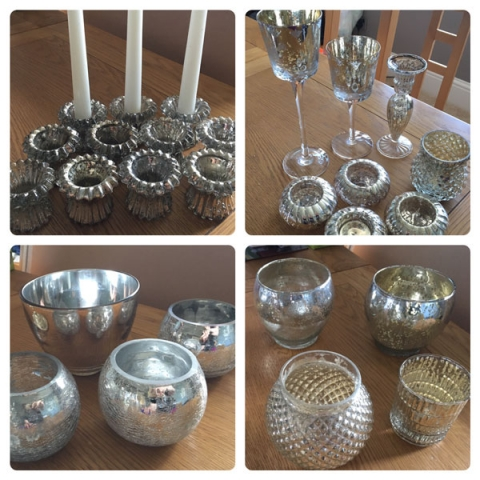 Various silver-look jars and candle holders for wedding centrepieces