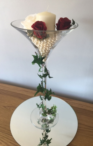 Tall glass martini vase with ivy, roses and pearls for wedding or event centrepiece