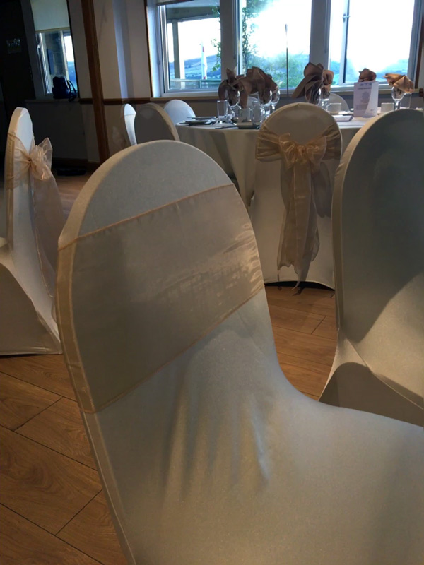 Ivory chair covers with peach bows, party chair covers