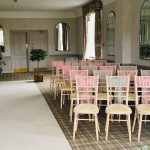 Chiavari chairs with pink and silver sashes, ivory aisle carpet and bay trees, Devonshire Fell