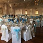 Silver and tiffany blue sashes on white chair covers for corporate event, Rendzevous Hotel, Skipton
