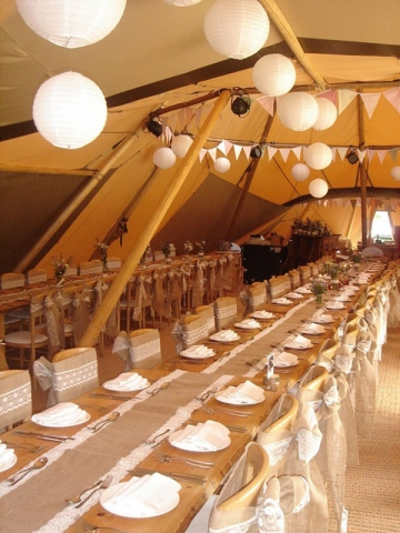 Tipi wedding table with hessian and lace table runner and sashes