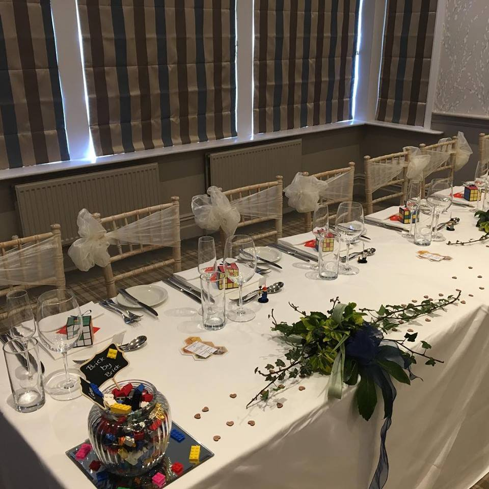 Top table chiavari chairs with ivory organza double bows Devonshire Fell