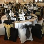 Black chair covers and gold sash, white chair covers and black sash, ball for new years eve