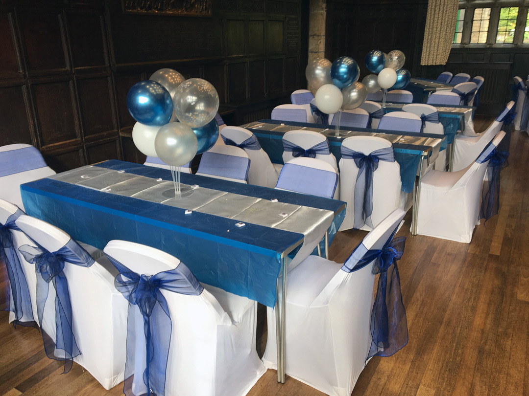 Christening decor. navy blue sashes and white chair covers, Clay House, Halifax