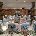 White cotton wedding chair covers, green and teal and lace sashes, Devonshire Arms Bolton Abbey