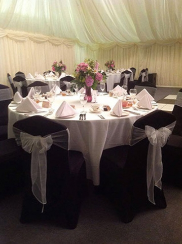 Black lycra wedding chair covers and white sashes, corporate event, ball, award ceremony
