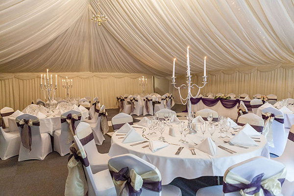 White chair covers with plum and ivory sashes, wedding reception, top table swagging, Halfway House, Baildon