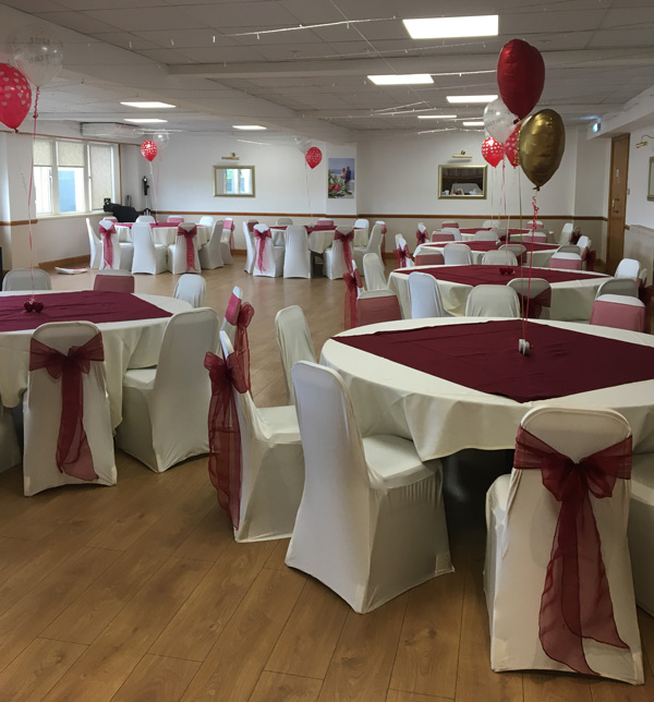 Party chair covers, ivory chair covers and burgundy sashes for celebration