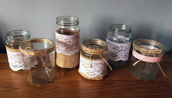 Hessian and lace jars for rustic wedding centrepiece with candles or flowers
