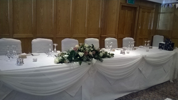 Top table swagging with white chiffon for wedding